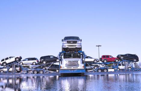 What is the difference between open and enclosed transport?
